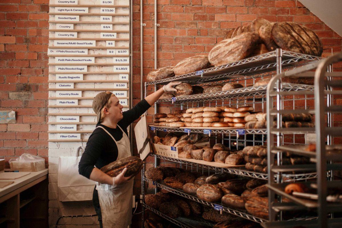 Baker grabbing some freshly baked bread at Baker Bleu.