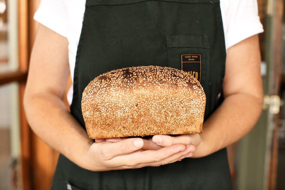 Cradling a freshly baked loaf of Falco.