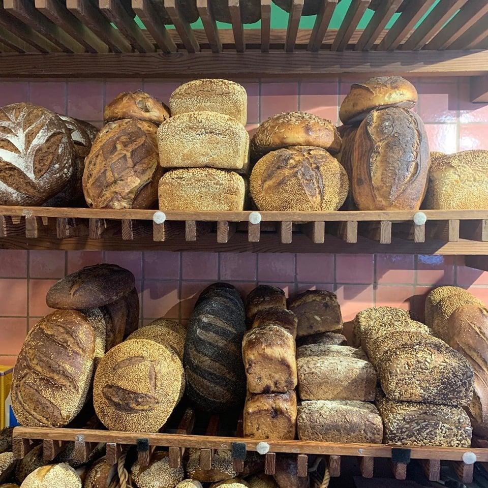 Stacks of freshly baked bread at Loafer Bread.