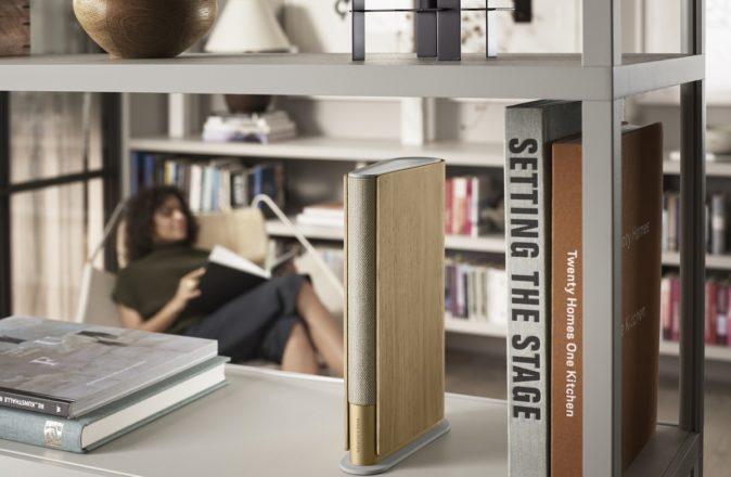 Beosound Emerge sitting on a bookshelf