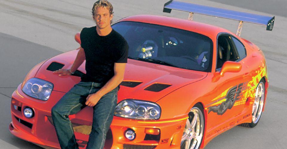 Paul Walker in front of the 1994 Supra